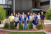 Martin/Martin group portrait at the Eagle Sculpture at the Clay Pathfinder Building at Laramie County Community College in Cheyenne, Wyoming.