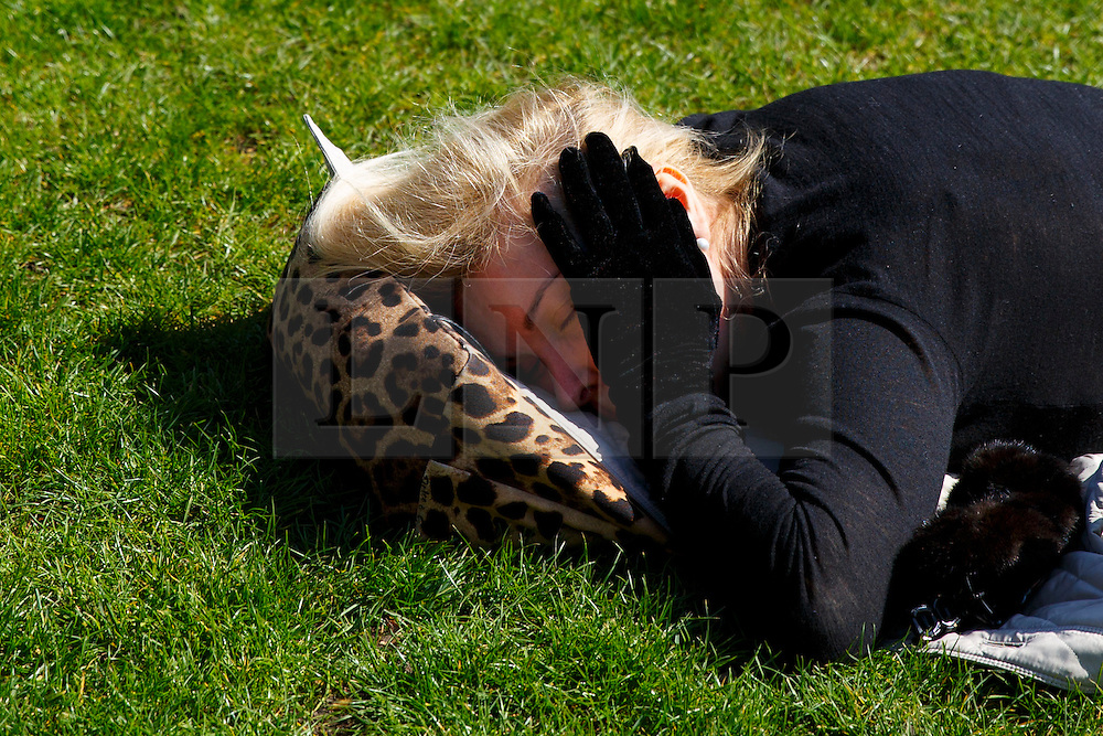 © Licensed to London News Pictures. 07/04/2015. LONDON, UK. A woman sleeping in St James's Park in London on Tuesday, 7 April 2015 as temperature hits 17C. Photo credit : Tolga Akmen/LNP