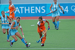 Sylvia Karres of the Netherlands in action against Argentina during Olympics Games Athletics day 12 on August 24, 2004 in Olympiako Kentro Khokei, Athens.