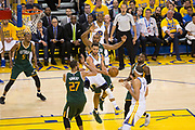 Golden State Warriors guard Stephen Curry (30) dishes the ball to Golden State Warriors center JaVale McGee (1) against the Utah Jazz during Game 1 of the Western Conference Semifinals at Oracle Arena in Oakland, Calif., on May 2, 2017. (Stan Olszewski/Special to S.F. Examiner)