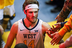 Nov 28, 2018; Morgantown, WV, USA; West Virginia Mountaineers guard Chase Harler (14) celebrates with fans after beating the Rider Broncs at WVU Coliseum. Mandatory Credit: Ben Queen-USA TODAY Sports