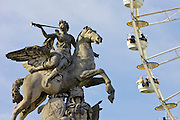 Horse and rider stone statue and ferris wheel, La Grande Roue,  in Place de la Concorde, Central Paris, France RESERVED USE - NOT FOR DOWNLOAD -  FOR USE CONTACT TIM GRAHAM