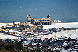 © Licensed to London News Pictures. 27/02/2018. Whitby UK. Whitby Abbey stands on the headland in the seaside town of Whitby which has seen snow today for the first time since 2010. Photo credit: Andrew McCaren/LNP