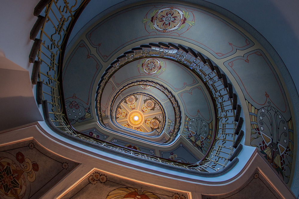 Looking upward towards a spiraling staircase in St. Petersburg, Russia. Photo by Adel B. Korkor.