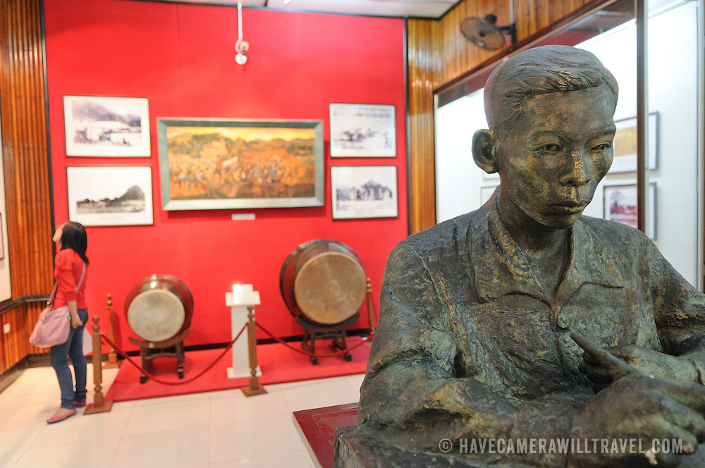 In the foreground at right is a statue made of gypsum titled Comrade Tran Phy Wrote Political Thesis by Nguyen Minh Tri (Dao Van Can) in 1961. The Museum of the Vietnamese Revolution in the Tong Dan area of Hanoi, not far from Hoan Kiem Lake, was established in 1959 and is devoted to the history of the socialist revolutionary movement in Vietnam.
