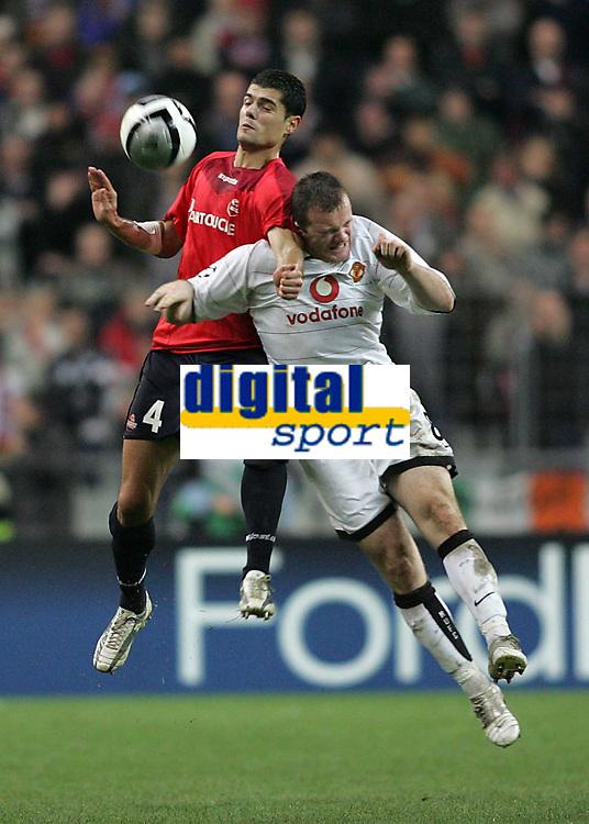 Photo: Lee Earle.<br /> Lille v Manchester Utd. UEFA Champions League.<br /> 02/11/2005. Manchester United's Wayne Rooney (R) clashes with Efstathios Tavlardidis.
