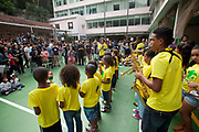 Children from the Pereira da Silva play instruments at the Favela Brass music school, Santa Teresa, Rio de Janeiro. The school was set up by British man Tom Ashe, providing free brass music lessons to children from the community. During the Rio 2016 Olympics, the group played a different show every day, being very well received by audiences.