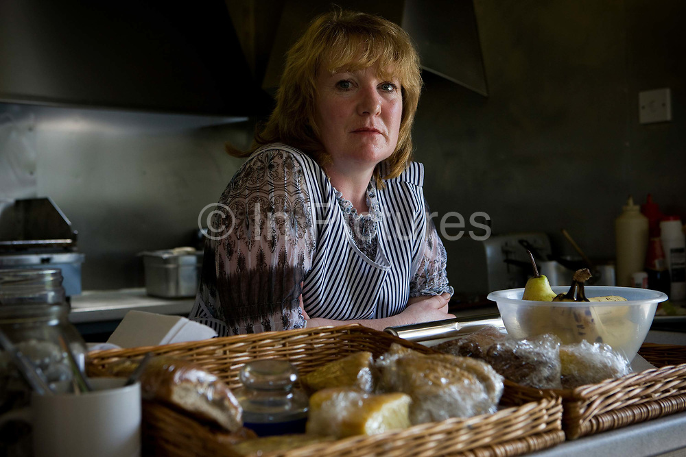 Trading for over 26 years, a female cook at The Butty Box snack bar along the A5 welcomes retirement on the 21st April 2010 in Shrewsbury in the United Kingdom.