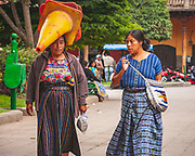 Just your average trip to the shops ...with a traffic cone on your head. ONe of the colourful scenes from walking the streets of Antiqua de Guatemala.