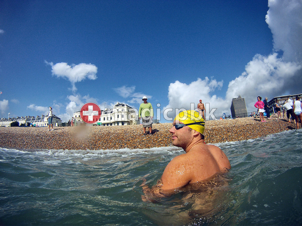 Gino Deflorian of Switzerland is listening to his coach Gerard Moerland (C) during a training session in the sea at the harbour in Dover, Great Britain, Sunday, Aug. 18, 2013. Gino Deflorian tries to become the first Swiss male swimmer who successfully swims the English Channel form Dover/Folkestone to Calais, France. (Photo by Patrick B. Kraemer / MAGICPBK)