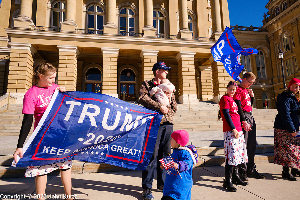 "28 NOVEMBER 2020 - DES MOINES, IOWA: People in front of the Iowa State Capitol during the ""Stop the Steal"" rally at the Iowa State Capitol Saturday. About 30 supporters of US President Donald Trump gathered at the Iowa State Capitol to rally in support of the President and in opposition to the outcome of the US election. They are a part of the ""Stop the Steal"" movement which has spread across the US. This is the fourth week that there have been ""Stop the Steal"" rallies at state capitols across the US. Most independent observers and election officials, both Republican and Democratic, have said the election was free and fair and that there was no election of fraud.          PHOTO BY JACK KURTZ"