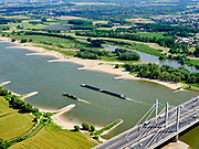 Nederland, Gelderland, gemeente Beuningen; 14–05-2020; Tacitusbrug over rivier de Waal. Tuibrug naast de oude (bestaande) Brug bij Ewijk. <br /> Tacitus bridge over the river Waal. Cable-stayed bridge next to the old (existing) Bridge at Ewijk.<br /> luchtfoto (toeslag op standaard tarieven);<br /> aerial photo (additional fee required)<br /> copyright © 2020 foto/photo Siebe Swart
