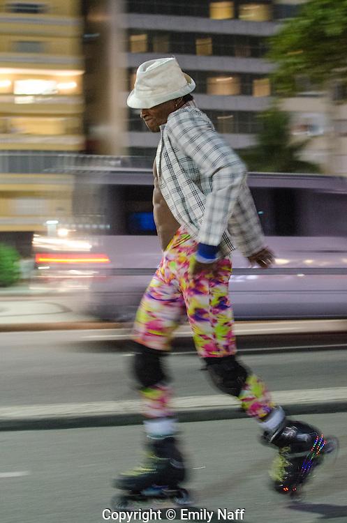 Street perfomer, rollerblading and dancing to Michael Jackson.  Copacabana, Rio de Janeiro, Brazil.