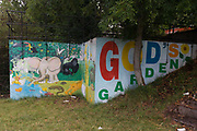 A mural depicting God's garden of Eden on wasteland alongside the river Avon in central Bristol. Representations of the animals of Noah's Ark are present, as children like to see them. An elephant, an ape and various other land creatures occupy the earth in a biblical image of paradise and harmony. And yet this is a dystopian landscape, forgotten by any local community and hidden from a roadside by undergrowth.