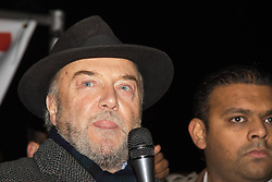 """Amid high security measures, hundreds of Kashmiri protesters, supported by George Galloway, demonstrate outside Wembley Stadium ahead of an address to more than 60,000 Indian expats by Prime Minister Narendra Modi at a 'UK Welcomes Modi' reception. Modi, a Hindu and his BJP party are accused of a wide range of human rights abuses against religious and ethnic minorities in India. PICTURED: George Galloway addresses the crowd of Kashmiri protesters, criticising Cameron for welcoming """"dictators Modi and Egypt's Sisi"""" to the UK."""