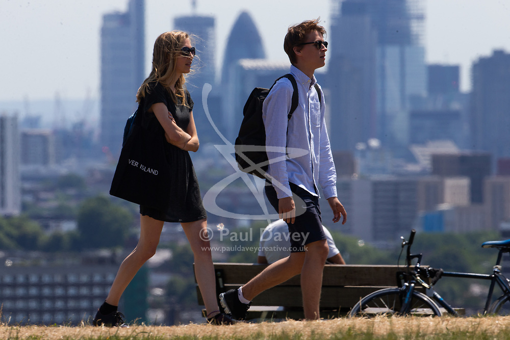 A couple enjoy the sunshine on Parliament Hill on another hot day in London. London, July 03 2018.