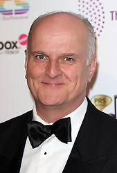 PETER DICKSON arrives for the Radio Academy Awards, London, United Kingdom. Monday, 12th May 2014. Picture by i-Images