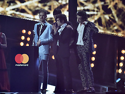 The 1975 with the award for Best British Group on stage at the BRIT Awards 2017, held at The O2 Arena, in London.<br /><br />Picture date Tuesday February 22, 2017. Picture credit should read Matt Crossick/ EMPICS Entertainment. Editorial Use Only - No Merchandise.