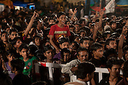Young men are celebrating the festival of Janamashtami, the birthday of Hindu God Krishna, in Bhopal, Madhya Pradesh, India, near the abandoned Union Carbide (now DOW Chemical) industrial complex.