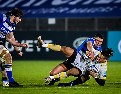 Josh Matavesi of Bath Rugby attempts a tackle on Paolo Odogwu of Wasps - Mandatory by-line: Andy Watts/JMP - 08/01/2021 - RUGBY - Recreation Ground - Bath, England - Bath Rugby v Wasps - Gallagher Premiership Rugby
