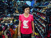09 JULY 2017 - SINGAPORE: A shoe seller in Tiong Bahru market. Tiong Bahru market, in the midst of the Tiong Bahru Housing estate, was the first indoor market in Singapore and is considered one of the best markets in Singapore. It was built in 1955 in an effort to organize vendors and get them off the neighborhood streets. Tiong Bahru neighborhood is now one of the most popular neighborhoods in Singapore for both expats and Singaporeans.    PHOTO BY JACK KURTZ