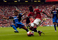 Photo: Jed Wee.<br />Manchester United v Seville. Pre Season Friendly. 12/08/2006.<br /><br />Manchester United's Louis Saha (R) fires in a shot before Seville's Daniel Alves can get a tackle in.