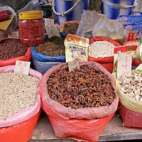 Asia, China, Chongqing. Chinese medicinal herbs in the street market.