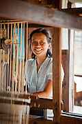 A weaver at the Ko Than Hlaing Weaving Factory built on Inle Lake in Shan State, Myanmar