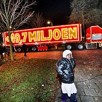 Nederland, Amsterdam , 1 januari 2015.<br /> 2015 begint goed voor mensen die 1107 als postcode hebben. De inwoners van de wijk Gaasperdam in Amsterdam Zuidoost hebben de Postcodekanjer gewonnen.<br /> Het bedrag van 43,7 miljoen euro wordt verdeeld onder iedereen die meespeelt met de postcode 1107. De helft daarvan wordt verdeeld onder mensen die ook de goede letters in hun postcode hebben. Wat die zijn, wordt vanavond bekendgemaakt.<br /> Foto:Jean-Pierre Jans