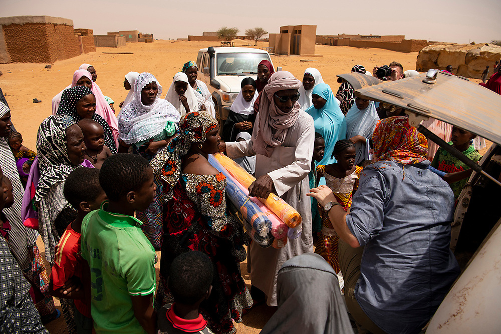U.S. Army Civil Affairs soldiers, pass out sewing supplies, gathered and donated by families of deployed soldiers and airmen to members of a village in Agadez, Niger, June 27, 2019.