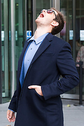London, October 22 2017. Actor Andrew Garfield gives an exaggerated yawn as he waits for fans to take his picture as he leaves the BBC after appearing on the Andrew Marr show at the BBC New Broadcasting House in London. © Paul Davey
