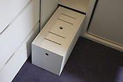 Detail of shoe/laundry storage box and top cupboard step