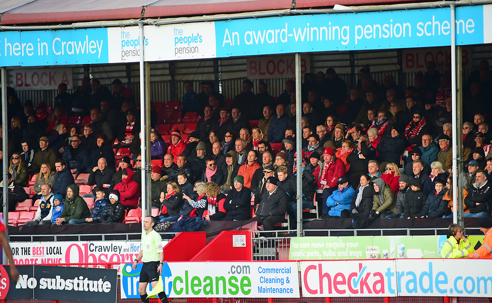 Lincoln City fans watch their team in action<br /> <br /> Photographer Andrew Vaughan/CameraSport<br /> <br /> The EFL Sky Bet League Two - Crawley Town v Lincoln City - Saturday 17th February 2018 - Broadfield Stadium - Crawley<br /> <br /> World Copyright © 2018 CameraSport. All rights reserved. 43 Linden Ave. Countesthorpe. Leicester. England. LE8 5PG - Tel: +44 (0) 116 277 4147 - admin@camerasport.com - www.camerasport.com