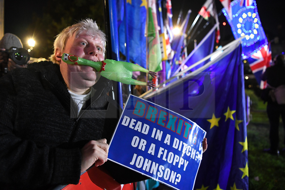 """© Licensed to London News Pictures. 22/10/2019. London, UK.  Boris Johnson impersonator Drew Galdron, 36 from Tooting (aka Faux Bojo) reacts outside The Palace of Westminster in front of College Green following crucial votes for PM Boris Johnson government. MPs backed his Withdrawal Agreement Bill - but minutes later voted against the timetable, placing Brexit """"in limbo"""". Photo credit: Guilhem Baker/LNP"""