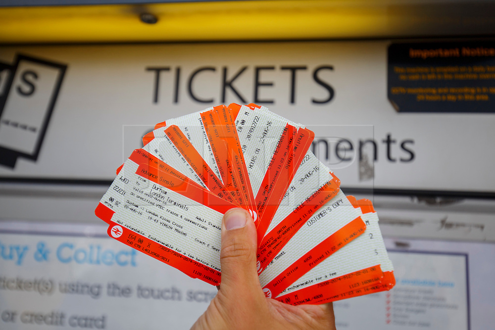 © Licensed to London News Pictures. 16/08/2016. London, UK. A train passenger holds the tickets bought from ticket machines outside London Bridge station in London on Tuesday, 16 August 2016. Rail fares will increase by 1.9% in January 2017, amid renewed calls from campaigners for the nationalisation of rail companies. Photo credit: Tolga Akmen/LNP