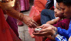 August 19, 2017 - Kathmandu, Nepal - Buddhists distribute offerings to devotees during Pancha Dan festival in Kathmandu,Nepal. Pancha Dan is the festival of five summer gifts donating the five different things including rice grains, unhusked rice grains, salt, money and pulses. (Credit Image: © Archana Shrestha/Pacific Press via ZUMA Wire)