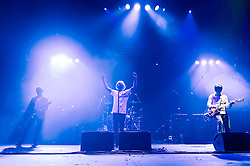 "© Licensed to London News Pictures. 08/06/2012. London, UK. The Charlatans perform live at Hammersmith Apollo, playing their 1997 and fifth studio album ""Telling' Stories"" in its entirety.  In this picture L to R -  Martin Blunt, Tim Burgess, Mark Collins.   Photo credit : Richard Isaac/LNP"