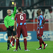 Referee's Martin ATKINSON show the yellow card to Trabzonspor's Arkadiusz GLOWACKI (C) during their UEFA Champions League group stage matchday 5 soccer match Trabzonspor between Inter at the Avni Aker Stadium at Trabzon Turkey on Tuesday, 22 November 2011. Photo by TURKPIX