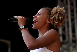 England Long Jump Athlete Jazmin Sawyers sings on stage during the Commonwealth Games Team England Parade in Victoria Square, Birmingham.
