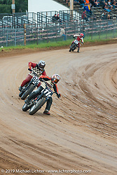 Harley-Davidson racers ride the track at the Pappy Hoel Half Mile Classic at the Sturgis Fairgrounds during the annual Sturgis Black Hills Motorcycle Rally. SD, USA. August 6, 2014.  Photography ©2014 Michael Lichter.