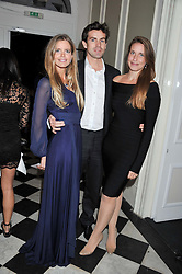 Left to right, KATIE READMAN, JACK SMALES and CHRISTOBEL READMAN at a reception hosted by Beulah London and the United Nations to launch Beulah London's AW'11 Collection 'Clothed in Love' and the Beulah Blue Heart Campaign held at Dorsia, 3 Cromwell Road, London SW7 on 18th October 2011.
