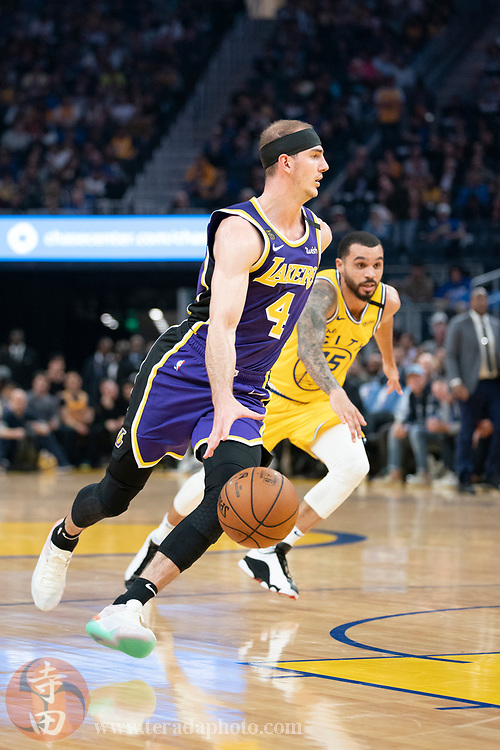 February 27, 2020; San Francisco, California, USA; Los Angeles Lakers guard Alex Caruso (4) dribbles the basketball against Golden State Warriors guard Mychal Mulder (15) during the second quarter at Chase Center.