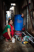 Woman Washing - Dharavi, Mumbai, India