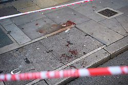 © Licensed to London News Pictures. 31/12/2018. London, UK. Blood on the pavement outside a Sianbury's Local store, at the scene at Fulham Palace Road in Hammersmith, West London where 39 people were arrested following the attempted murder of a man in a stabbing. Photo credit: Ben Cawthra/LNP
