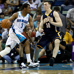 April 3, 2011; New Orleans, LA, USA; New Orleans Hornets point guard Chris Paul (3) drives past Indiana Pacers power forward Tyler Hansbrough (50)during the fourth quarter at the New Orleans Arena. The Hornets defeated the Pacers 108-96.  Mandatory Credit: Derick E. Hingle