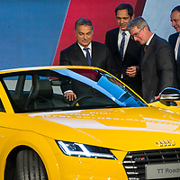 Viktor Orban (2nd L) prime minister of Hungary and Rupert Stadler (R) Chairman of the Board of Audi Management inspect the first Audi TT Roadster manufactured after it was introduced during the official production launch event in the Audi factory in Gyor (about 120 km West of Budapest), Hungary on November 05, 2014. ATTILA VOLGYI