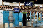 Shop fronts in Thimphu: Your Size, Delek Restaurant and Bar. Thimpu, Druk Yul, Bhutan. 13 November 2007.