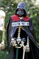 30 October 2015. New Orleans, Louisiana.<br /> The Skeleton Krewe mansion on St Charles Avenue at the corner of State Street draws crowds with its satirically spooky Halloween decorations. Republican candidate for Governor David Vitter stars as 'Darth Vitter.'<br /> Photo©; Charlie Varley/varleypix.com