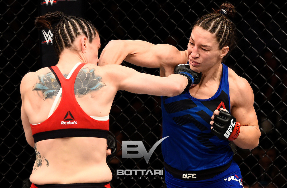 LAS VEGAS, NV - DECEMBER 03:  (R-L) Sara McMann and Alexis Davis of Canada trade punches in their bantamweight bout during The Ultimate Fighter Finale event inside the Pearl concert theater at the Palms Resort & Casino on December 3, 2016 in Las Vegas, Nevada. (Photo by Jeff Bottari/Zuffa LLC/Zuffa LLC via Getty Images)