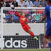 Goalkeeper Luis Robles, New York Red Bulls, makes a fine save during the New York Red Bulls V Colorado Rapids, Major League Soccer regular season match at Red Bull Arena, Harrison, New Jersey. USA. 15th March 2014. Photo Tim Clayton